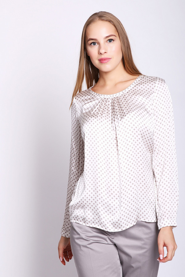 Блузa TaifunБлузы<br>Блуза белого цвета. На ткани имеется рисунок в виде ромбиков. Фасон свободный, длинна до бедер. Рукава длинные, заканчиваются манжетами с застежкой на пуговицу. Ворот округлый , впереди расположены небольшие складки. Состав ткани 100 % вискозы. Блуза очень красива и удобна.