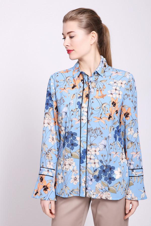 Блузa TaifunБлузы<br>Блуза женская голубого цвета от немецкого бренда Taifun. Модель выполнена прямым фасоном. Изделие дополнено откладным воротом на стойке, застежка на пуговицы, втачными, длинными рукавами с воланами. Ткань имеет разноцветный принт. Состав: 100% полиэстер. Сочетать можно с различными брюками, юбками.