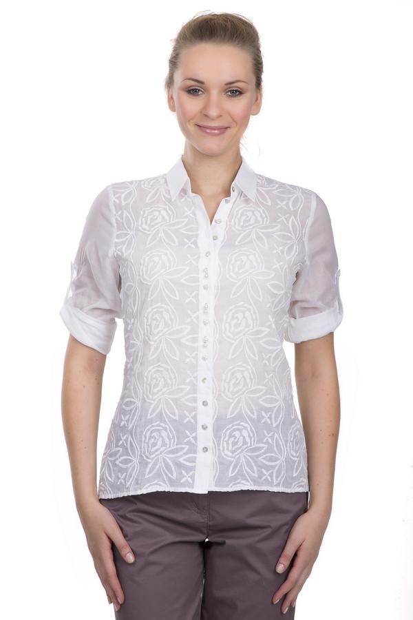 Блузa SE StenauБлузы<br>Блуза на пуговицах для женщин, от бренда SE Stenau. Это блуза белого цвета, украшенная вышивкой роз нитью в цвет. Изделие дополнено: отложным воротником, планкой на пуговицах, удлиненной спинкой и рукавами длиной до середины плеча, который подстегивается пуговицей. Прекрасно будет смотреться как с  юбками , так и с  брюками .<br><br>Размер RU: 46<br>Пол: Женский<br>Возраст: Взрослый<br>Материал: хлопок 100%<br>Цвет: Белый