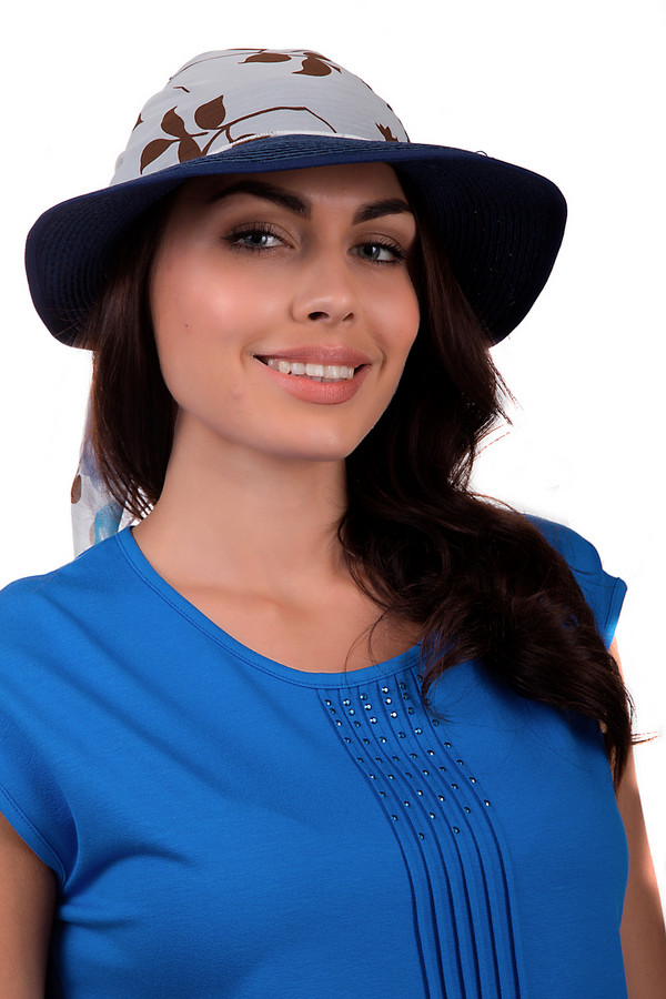 Шляпа WegenerШляпы<br>Стильная женская шляпа от бренда Wegener белого, серого, коричневого и голубого цветов. Изделие выполнено из бумаги. Эта модель предназначена для летнего сезона. У шляпы широкие поля. Дополнена завязками сзади. Оформлена ярким цветочным рисунком. Такой головной убор является отличным украшением летнего образа и защитой от солнца.<br><br>Размер RU: один размер<br>Пол: Женский<br>Возраст: Взрослый<br>Материал: бумага 100%<br>Цвет: Разноцветный