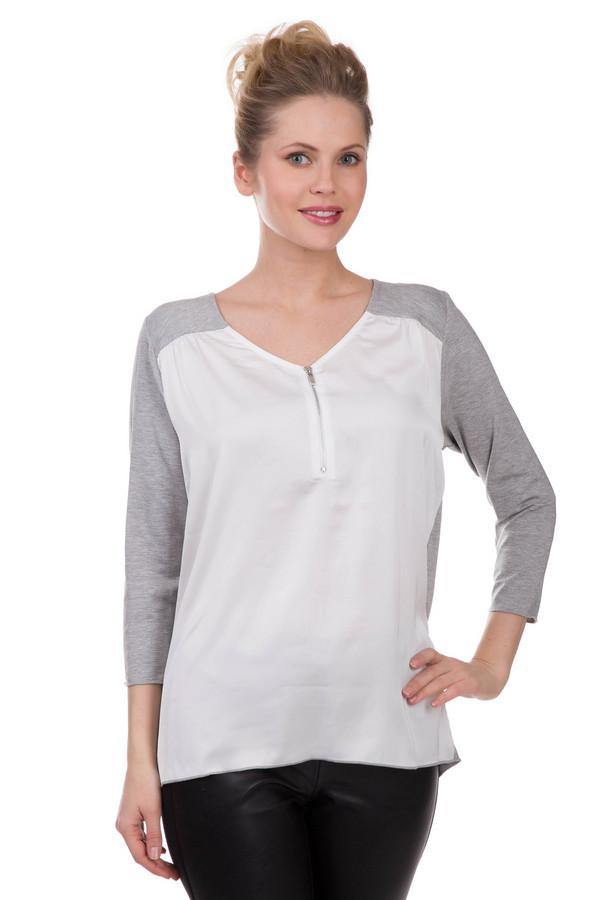 Блузa Betty BarclayБлузы<br>Красивая и скромная блуза Betty Barclay цвета серый с белым. В состав модели входят эластан и вискоза. Незаменима для ношения в демисезон. Блуза дополнена небольшим серебристым замочком на груди. V-образный вырез подчеркнет достоинства шеи и бюста. Подойдет тем, кто предпочитает оттенять свою естественную красоту мягкими, светлыми цветами. Одновременно элегантна и нейтральна.<br><br>Размер RU: 44<br>Пол: Женский<br>Возраст: Взрослый<br>Материал: эластан 5%, вискоза 95%<br>Цвет: Белый