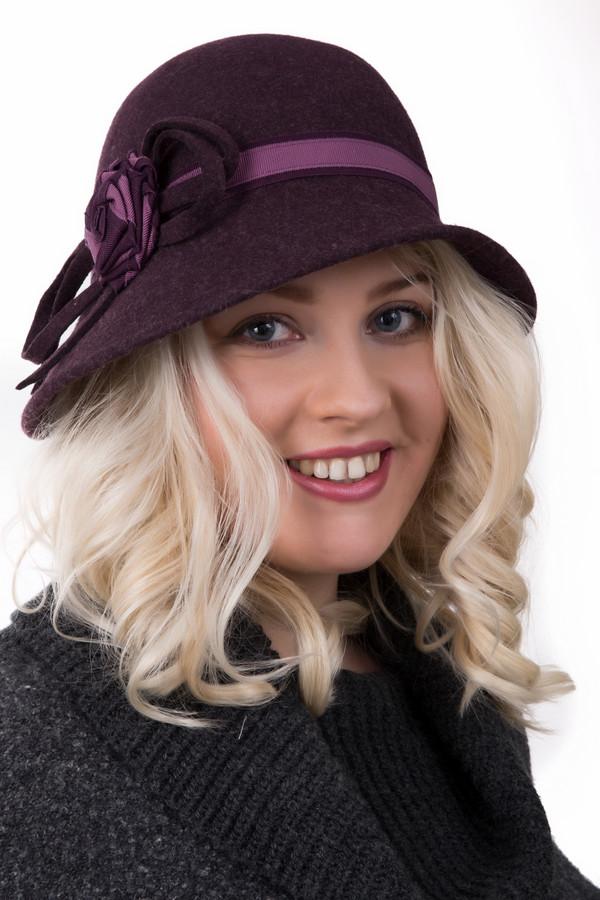 Шляпа WegenerШляпы<br>Шляпа Wegener женская. Фиолетовый с розовым здесь выглядят просто бесподобно! Сочетание разных цветов и фактур просто завораживает, фантазия дизайнеров поистине неистощима. Состав: 100%-ная шерсть. Демисезонное изделие для настоящих леди. Элегантная шляпа с довольно широкими краями и небанальным декором, безусловно, найдет своих почитательниц!<br><br>Размер RU: один размер<br>Пол: Женский<br>Возраст: Взрослый<br>Материал: шерсть 100%<br>Цвет: Розовый