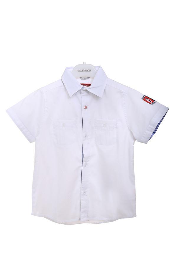 Рубашка SarabandaРубашки<br>Рубашка Sarabanda белая для мальчика. Детские вещи обязательно должны быть удобными. Эта рубашечка вполне соответствует данному правилу. Застежка на пуговицы, нагрудные карманчики и свободный крой обеспечат удобство ребенка. Кроме того, рубашка красива: обратите внимание на лого на рукаве рубашки, продублированную планку застежки, петельку сзади и верхнюю пуговицу контрастного цвета. Состав: полиамид, хлопок, эластан.<br><br>Размер RU: 26;98<br>Пол: Мужской<br>Возраст: Детский<br>Материал: эластан 4%, полиамид 27%, хлопок 69%<br>Цвет: Белый
