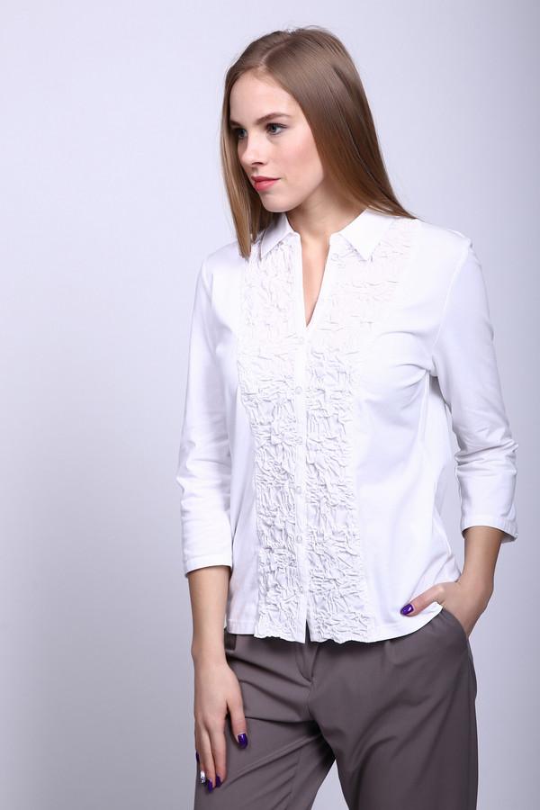Блузa ErfoБлузы<br>Блузa Erfo белая. Стильная вещь с кружевной вставкой по центру лифа вдоль застежки. Особенно хорошо она подойдет для романтических натур, любящих женственную соблазнительную одежду. Отложной воротничок и рукав три четверти – главные фишки этого изделия. Хорошо сморится как под брюки, так и под юбку. Можно носить блузу как отдельно, так и под жакет. Состав: хлопок и эластан.<br><br>Размер RU: 46<br>Пол: Женский<br>Возраст: Взрослый<br>Материал: эластан 7%, хлопок 93%<br>Цвет: Белый
